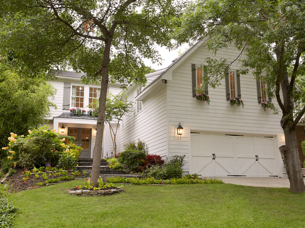 The farmhouse feel of the home's exterior influenced Emily's decor choices for the interior. When her family purchased the home, she painted the front doors and added an overhang, shutters, flowerboxes and new landscaping.