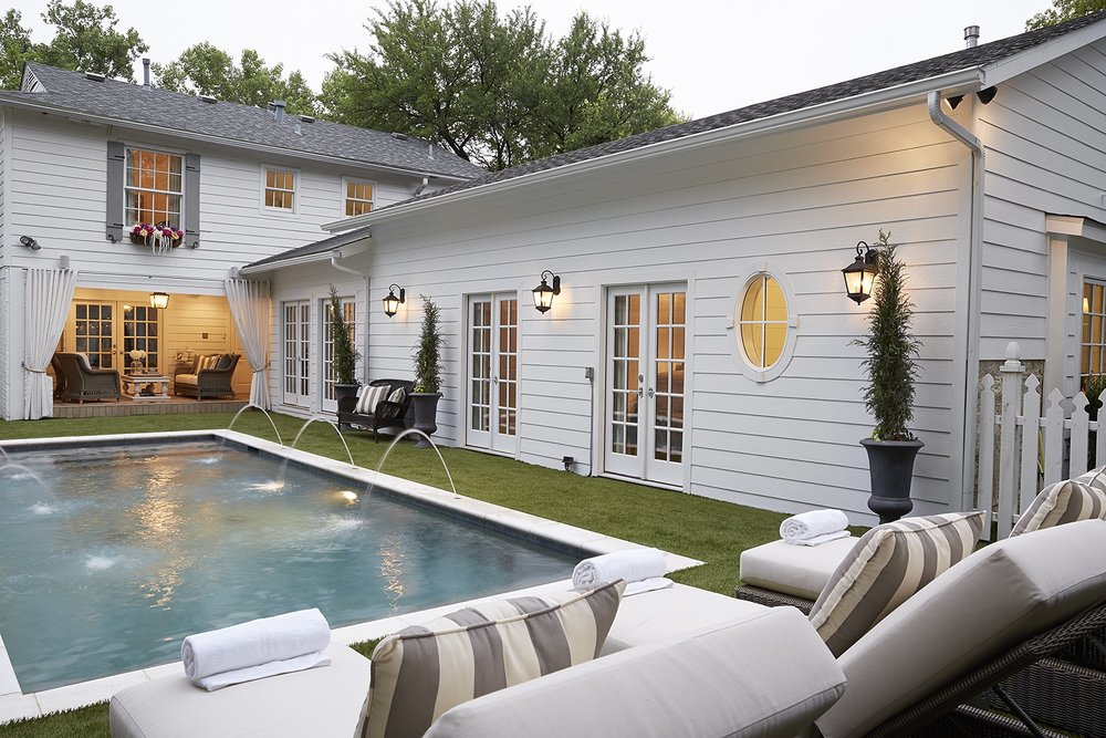 Emily and her husband updated their backyard by removing a deck, adding a pool and installing artificial grass. The renovated master suite has French doors that lead to the pool.
