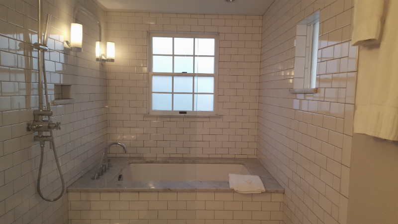 Walk-in shower with marble hex tile floor, subway tile walls, and large soaking tub. HEAVEN!