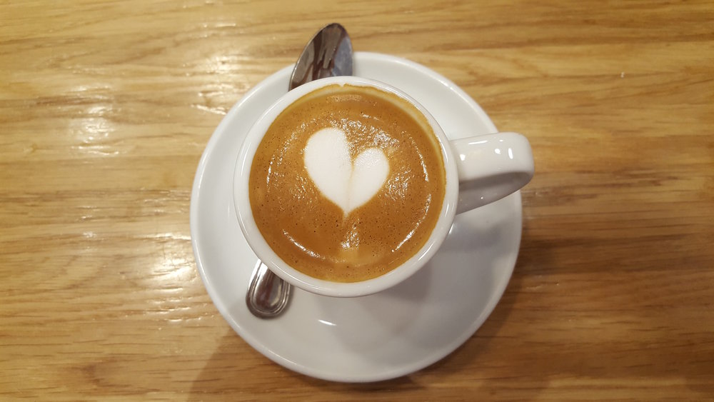 An authentic caffè macchiato at Rosetta Bakery