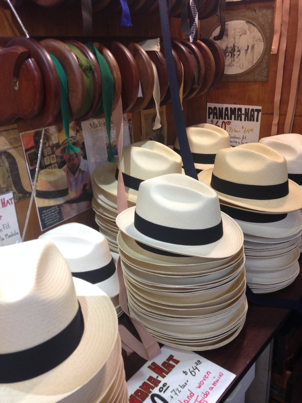 Shopping for Panama hats at Ole Curiosidades. So many ribbon options!