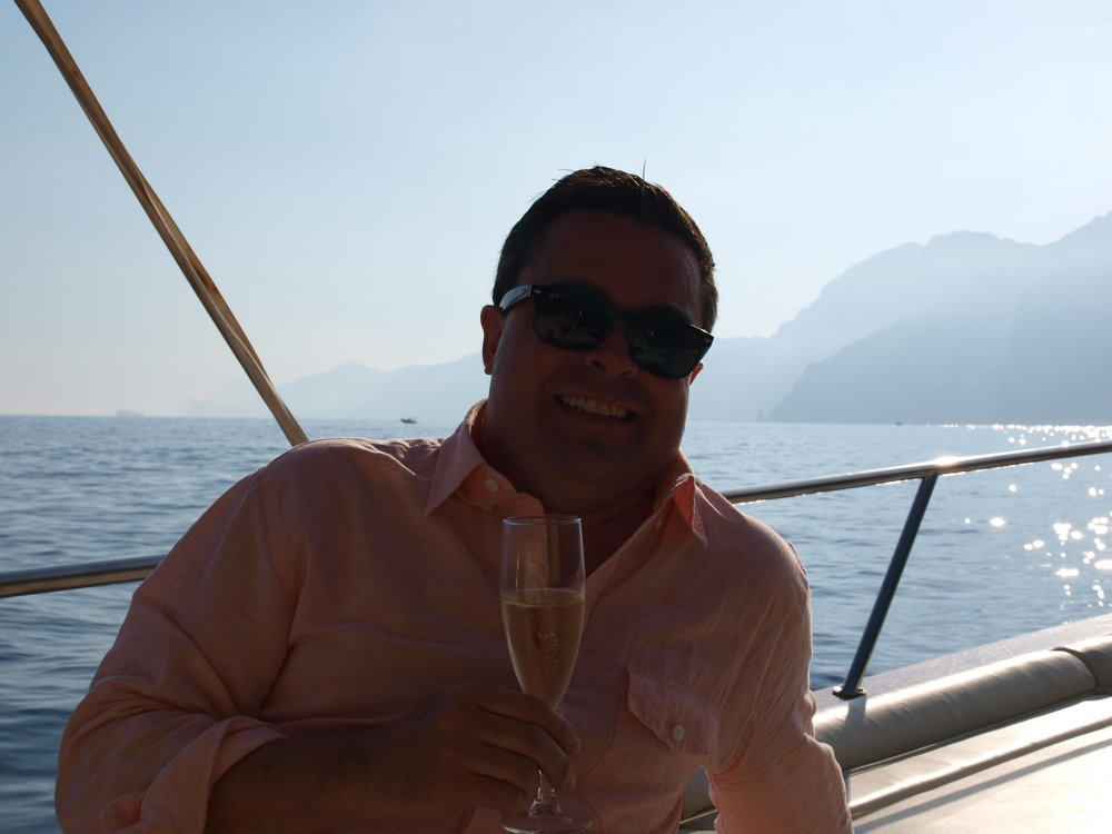 Enjoying a glass of bubbly on our private boat ride to Capri