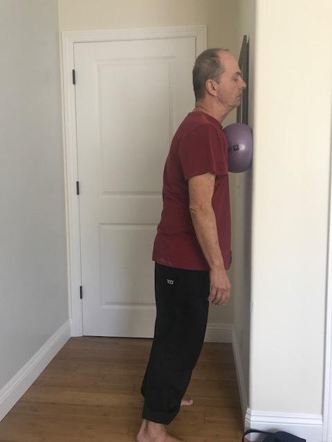 Here Kent is using a Yoga Tune Up Coregeos ball to passively open the front of his chest. To do the more specific work I described above on the pecs and subclavius a smaller ball, like a tennis ball or the Yoga Tune Up Therapy Balls.
