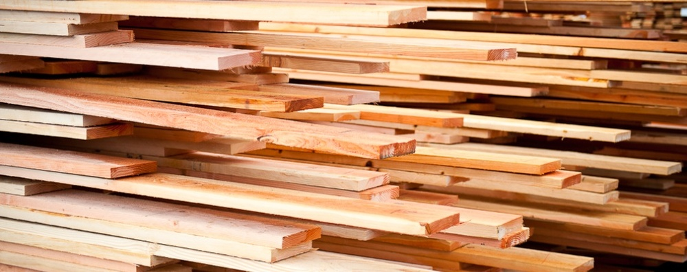 dimensional lumber pile with some planks pulled out at different places