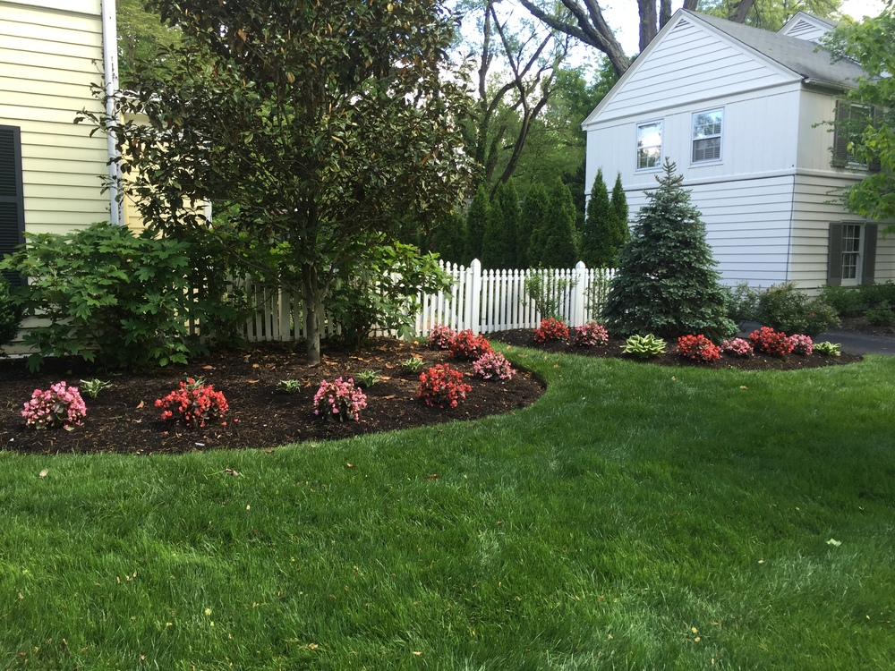 mulching and bed edging and spring clean up landscaping
