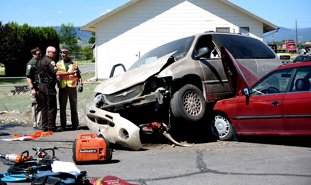 """I know photographically this photo isn't much. But the story was fantastic. I mean really, how often does one hear the words """"airborne"""" and """"minivan"""" together? The van went off the road, went airborne, and landed on top of the red car. It was funny but that's mainly because no one was seriously hurt."""