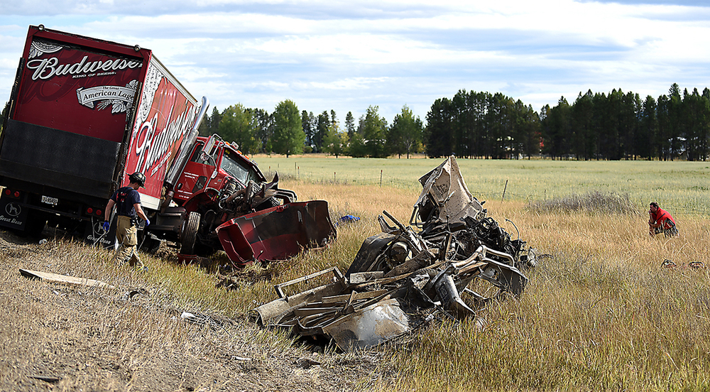 One of the most devastating wrecks I have ever seen: The driver of a Budweiser truck takes a moment off to the side of a collision with a Ford f250 truck on September 9, at the intersection of U.S. 93 and Farm-to-Market Road north of Whitefish.