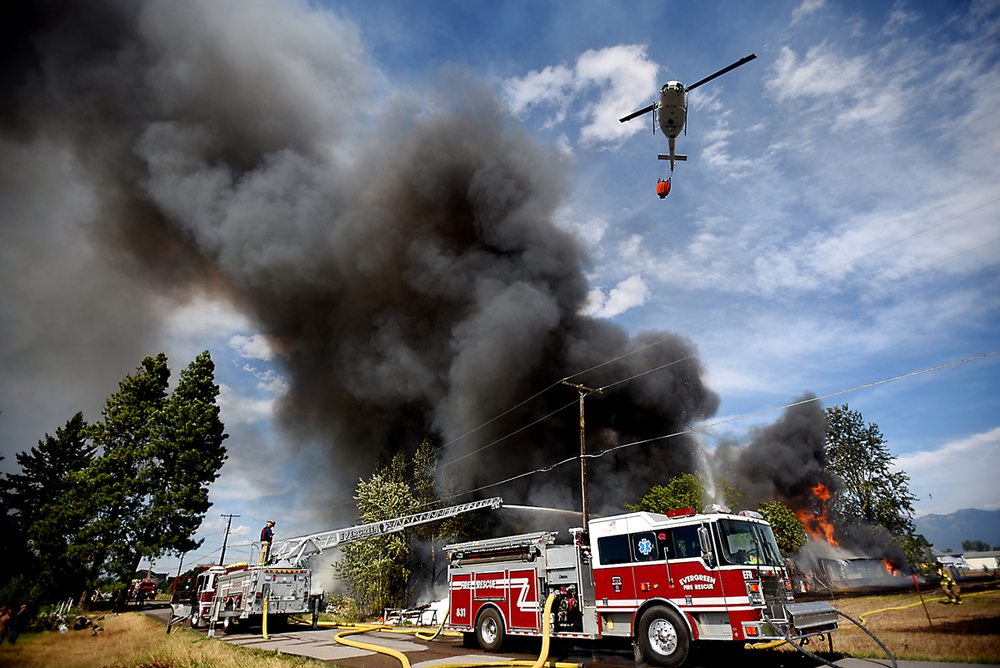 Smoke billows from a massive fire on Mountain View Drive in Evergreen on Wednesday, August 5. (Brenda Ahearn/Daily Inter Lake)
