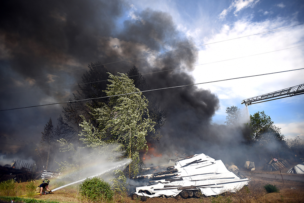 High winds contributed to the structure fire/ grassland fire on Mountain View Drive in Evergreen on Wednesday, August 5. (Brenda Ahearn/Daily Inter Lake)
