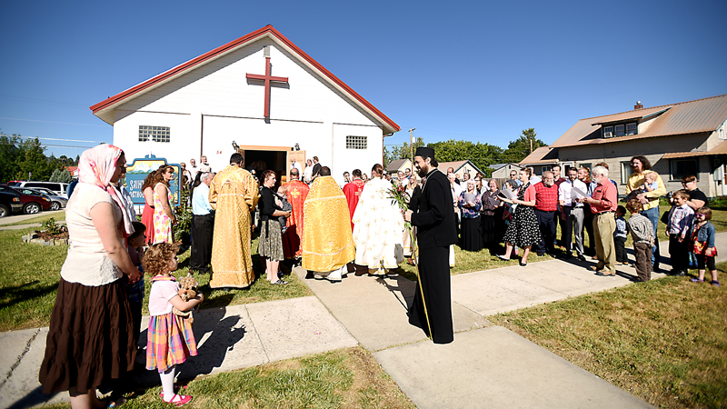 Bishop Maxim of the Serbian Orthodox diocese of Western America is greeting by the crowd gathered outside Saint Herman Orthodox Church in Kalispell on Sunday, July 19, for the blessing of the temple and the ordination of the Rev. Daniel Kirk, the first priest to serve at Saint Herman and the first Orthodox priest to be ordained in the state of Montana. (Brenda Ahearn/Daily Inter Lake)