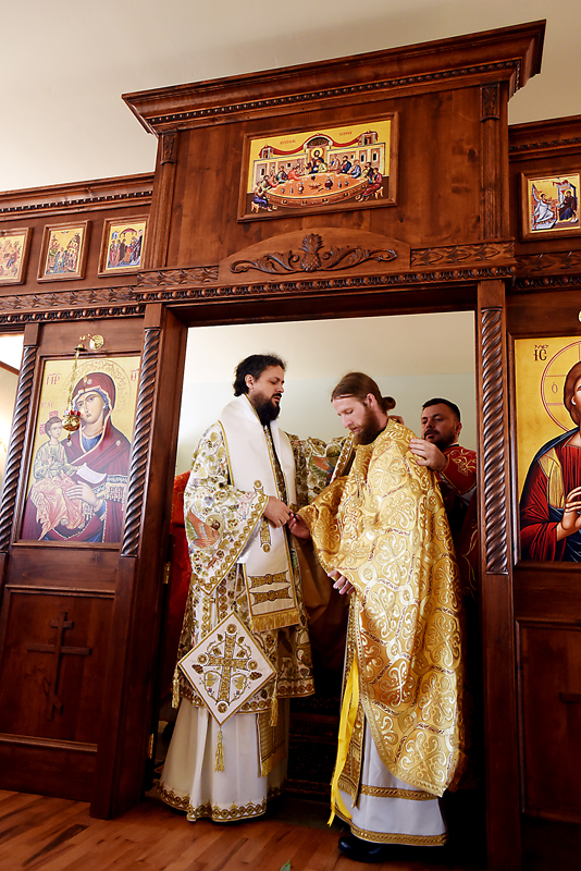 The Rev. Daniel Kirk receives his vestments, the robe worn by clergy, on Sunday, July 19. (Brenda Ahearn/Daily Inter Lake)