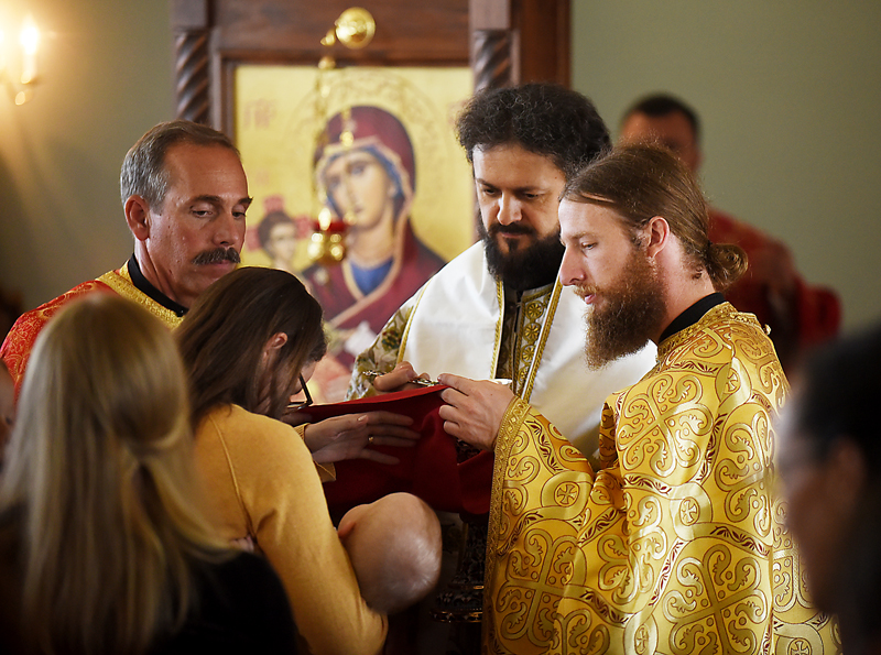 The Rev. Daniel Kirk take part in offering communion and blessings for the members of Saint Herman Orthodox Church on Sunday, July 19, in Kalispell. (Brenda Ahearn/Daily Inter Lake)