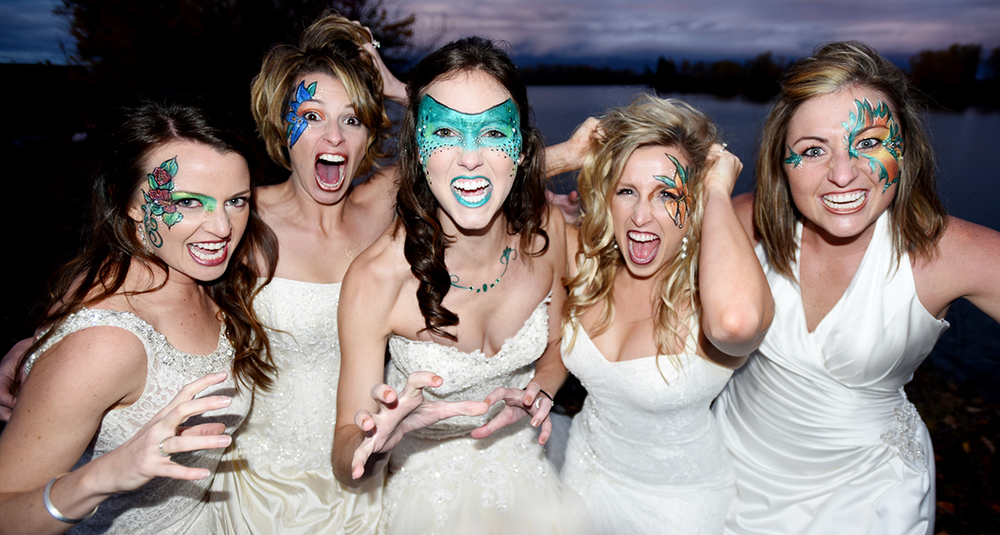 """One of my favorite photos of the year was this one. I asked Katie (whose wedding I shot in June) and Mandy, (whose wedding I shot last year) if they would be willing to get a few more brides to get super glammed up and pretend to be """"Bridezillas."""" These ladies were awesome and this photo shoot was a scream. Thanks to Kathleen Fancis of Fancy Face Design for the face painting. It was exactly what I wanted."""