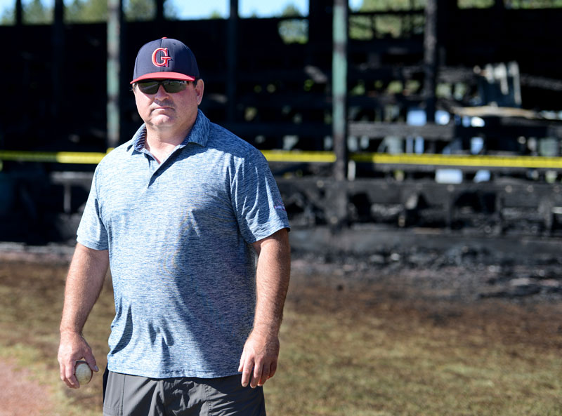 coach baseball stadium fire ruins