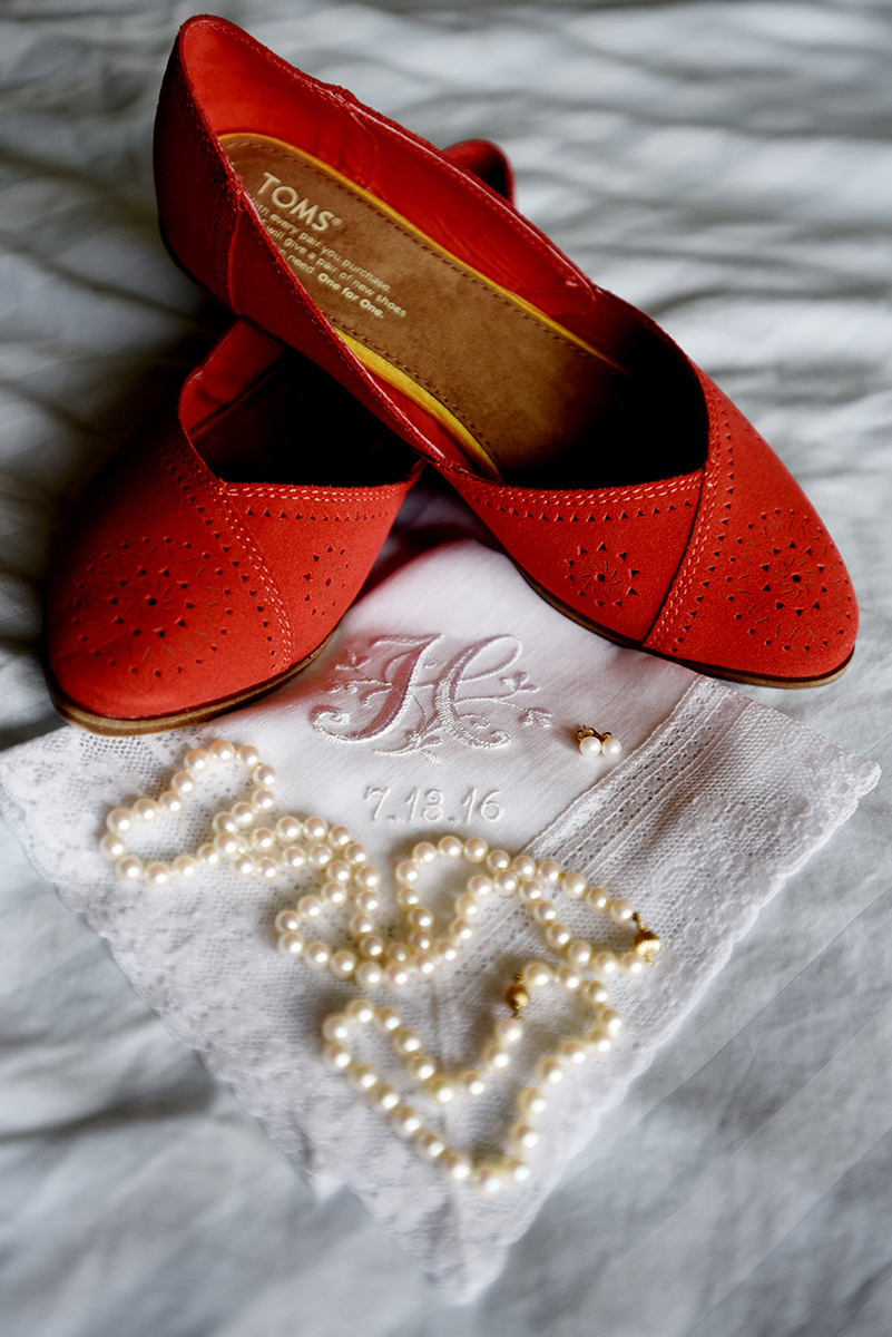 wedding detail with red shoes