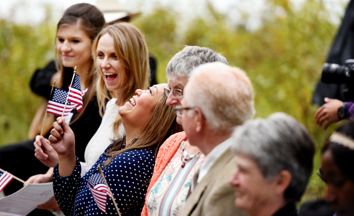 Bernadette Binoya Fuhst of the Philippines throws her head back joyfully after receiving a small American Flag as well as her American Citizenship certificate. (Brenda Ahearn/Daily Inter Lake)