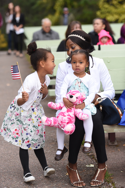 Sandrine Tochem of Chad with her daughters Eve, 5, and Alexa, 2, share a moment together before the start of the Naturalization Ceremony in Glacier National Park on Wednesday, September 21. (Brenda Ahearn/Daily Inter Lake)