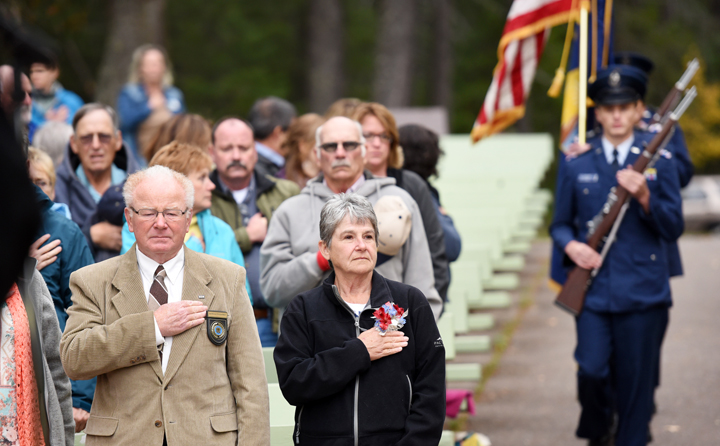 From left, Date-Ellyn Dalles Randle and Lana Lee Schock, both of Canada stand for the Advance of the Colors by the Kalispell Civil Air Patrol during the Naturalization Ceremony in Glacier National Park on Wednesday, September 21. (Brenda Ahearn/Daily Inter Lake)
