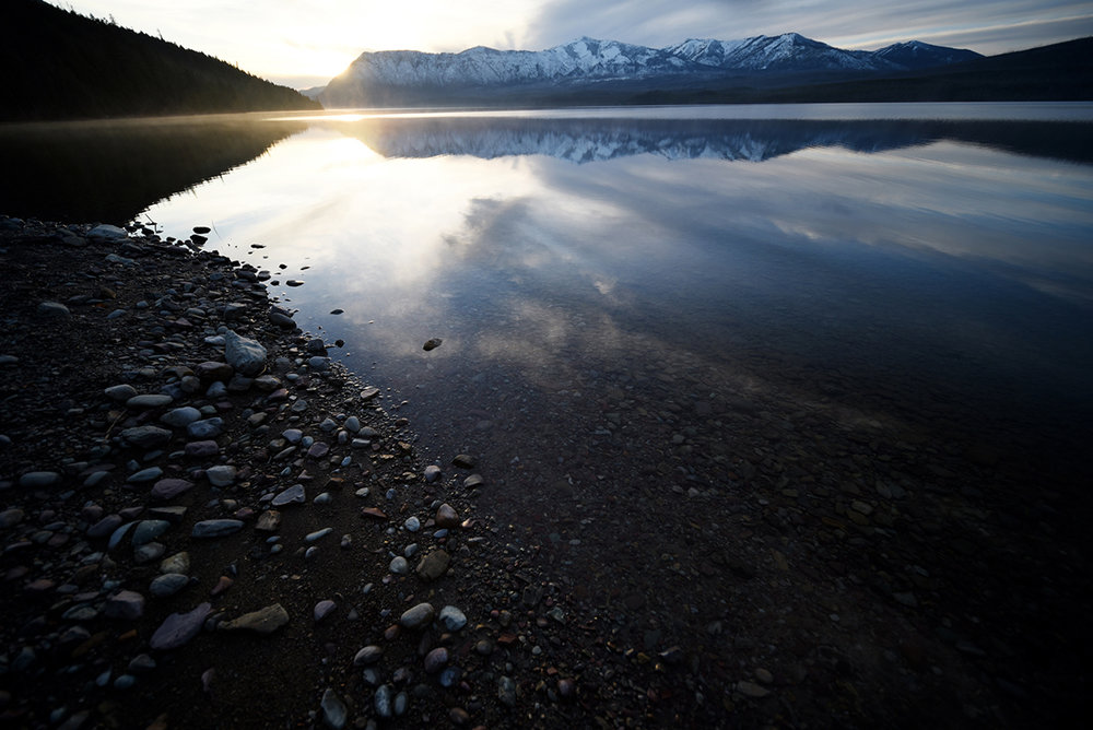 Lake McDonald in Glacier National Park at sunset. The photo above is a little creek running into the lake. This photo is what I saw heading back from that creek. It never fails to amaze me, how sometimes I get so focused on what is happening in front of me, when in reality, there is something equally amazing happening behind me. I've made it habit to periodically check over my shoulder when the light hitting my subject is particularly good. It has become a sign that there must be something good happening in the sky behind my back.