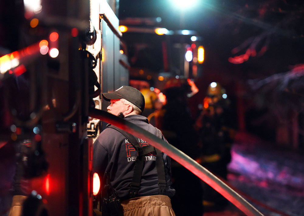 One of the best parts of being a journalist is getting to work so closely with my local first responders. This image is of Fire Department engineer F. Ray Ruffatto checking on the ladder truck outside 327 Ponderosa Lane in the early hours of Saturday morning, February 20, north of Kalispell. Kalispell and West Valley Firefighters responded to a report of smoke and another possible flare up around 2:30 a.m. A structure fire was initially reported and responded to at the residence on Friday evening.