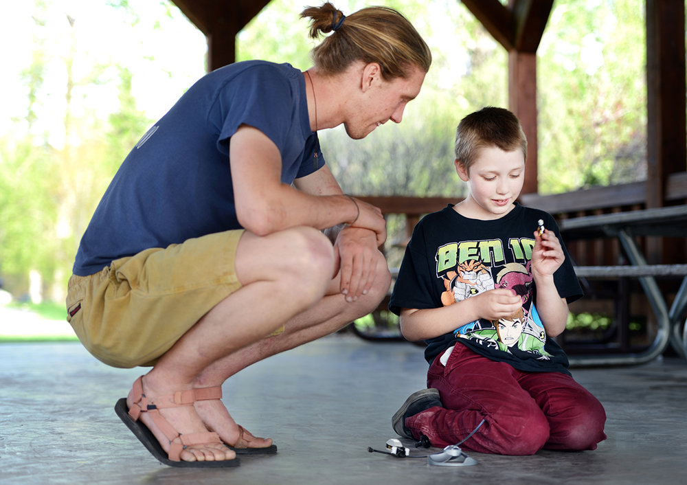 "This is one of those quieter moments that make up our community. Leif Castren of Kalispell with his ""little brother"" Rylan, 10, at Lawrence Park on Thursday, April 21, in Kalispell. Rylan has been in the Big Brothers Big Sisters program since 2014. This photo was done in advance of the BBBS fundraiser in an effort to raise awareness of the event and get more people involved."