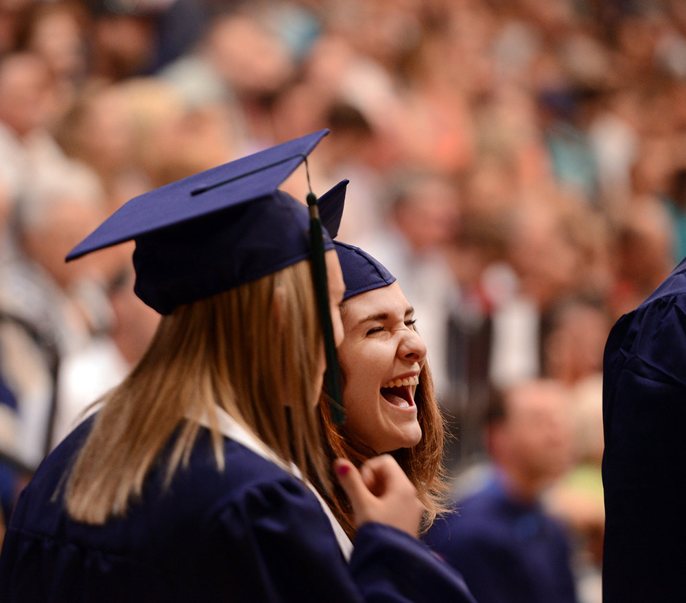 Jordan Griffith shares a laugh with a classmate before climbing the stage to receive her diploma on Saturday, June 4, at the Glacier High School Class of 2016 Commencement ceremony. I have a sort of love/hate relationship with graduation ceremonies. On the one hand, they are a target rich environment. On the other, there is so much going on I feel like I miss moments because they are harder to anticipate. But in spite of my hatred of the song Pomp and Circumstance, I always try to remember my graduation, how proud and happy I was. That helps me relate better to what they're feeling and I think helps me photograph them.