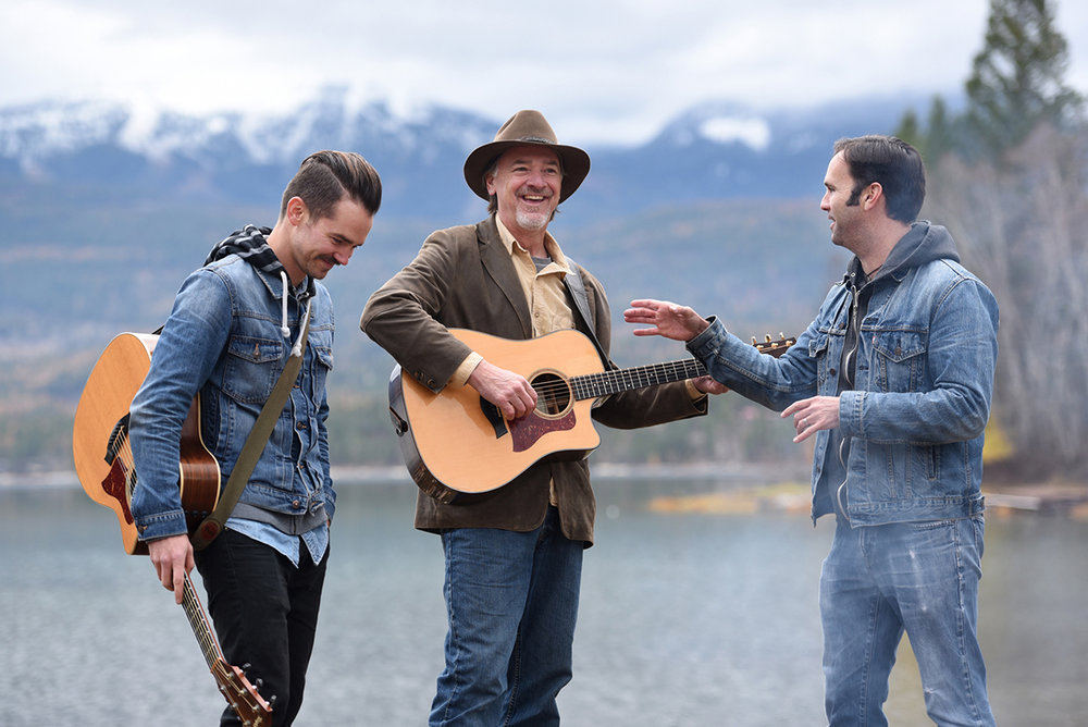 From left, Mike Murray, David Walburn and Nick Spear play a song during a photo shoot at Whitefish Lake State Park on Tuesday, Nobember 1. The three will be performing in the Stumptown Songwriter's Circle will be Thursday, November 10 at 7:30 at the O'Shaughnessy. So many times the goal of the newspaper is not to go to an actual event, but rather to make photos and stories before hand so we can let readers know something good is coming up. That's what lead to this photo. It was delightful to watch these three singer/songwriter/storytellers with their easy rapport and off the charts talent. This was definitely one of my favorite moments of the year. I also went to that concert and it was one of the best I've seen.