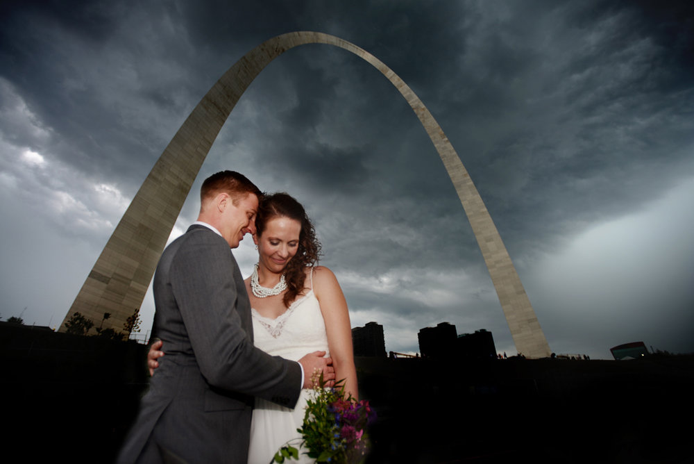Bride and groom under the Gateway to the West in St. Louis