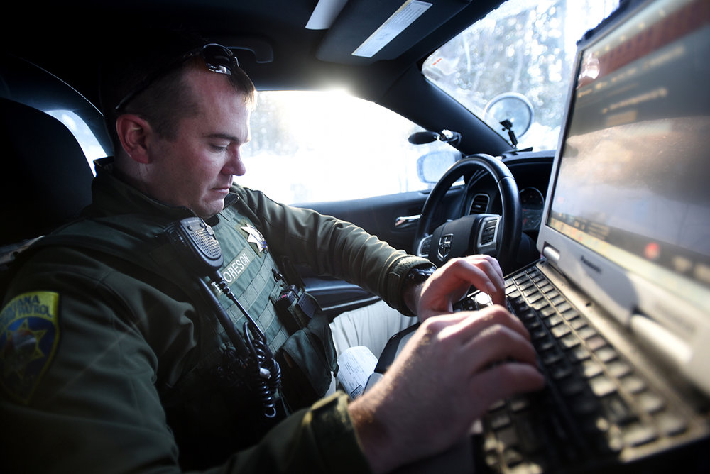 Trooper Eric Thorsen enters information in his computer as he investigates a two vehicle wreck on Wednesday, January 4. For any crash where there is more than $500 in damage the Montana Highway Patrol must do an investigation. Numbers for 2016 have not yet been released but there were 1846 crash investigations for District 6 in 2013, 2002 in 2014, and 2089 in 2015. District 6 consistently has one of the highest numbers of crash investigations.