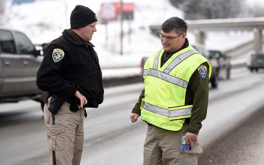 Trooper Jim Hawkins, left, speaks with Trooper Bob Hensley at the scene of a two vehicle wreck on Tuesday, January 17, in Evergreen.