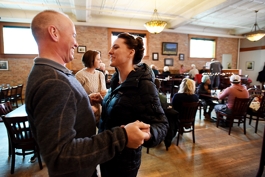 Bride and groom see each other for the first time as the two families gather for a breakfast at Split Rock Cafe in Kalispell.