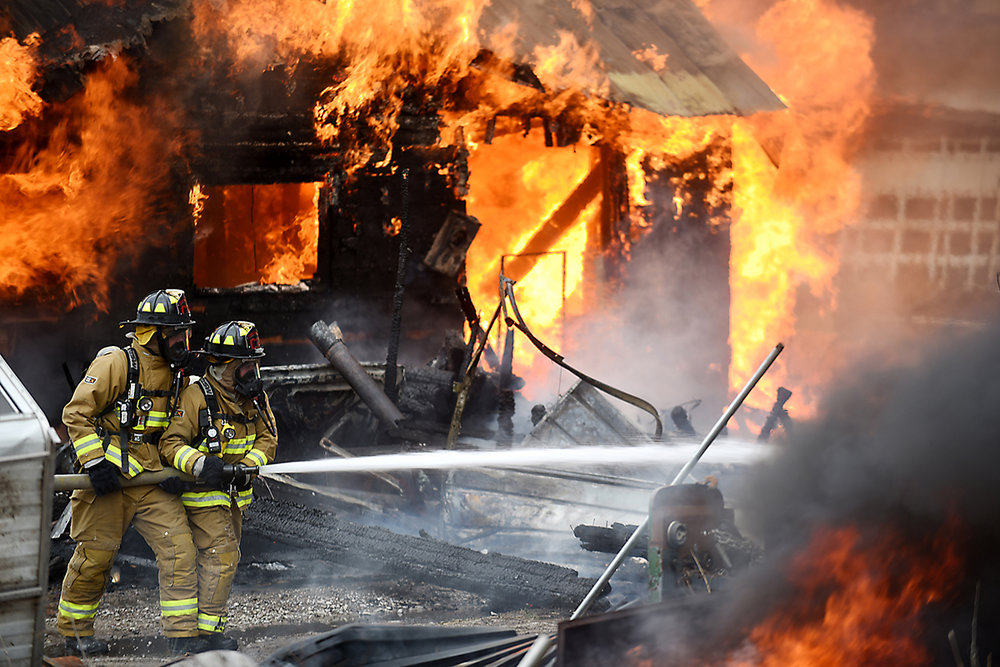 Firefighters from Columbia Falls battle flames in a fully involved structure fire on Thursday, May 14, on Brunner Road southwest of Columbia Falls. The fire, which started in the family's welding shop around 5 p.m., completely destroyed the home of Stan and Carol Ortel. (5/14/15)