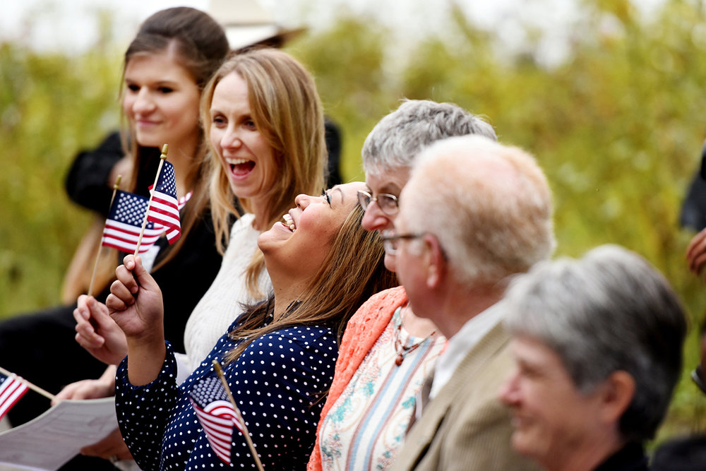 Bernadette Binoya Fuhst of the Philippines throws her head back joyfully after receiving a small American Flag as well as her American Citizenship certificate on Wednesday, Sept. 21, in Glacier National Park. Eleven new citizens, from seven nations, took the Oath of Allegiance on the shores of Lake McDonald. (9/21/16)