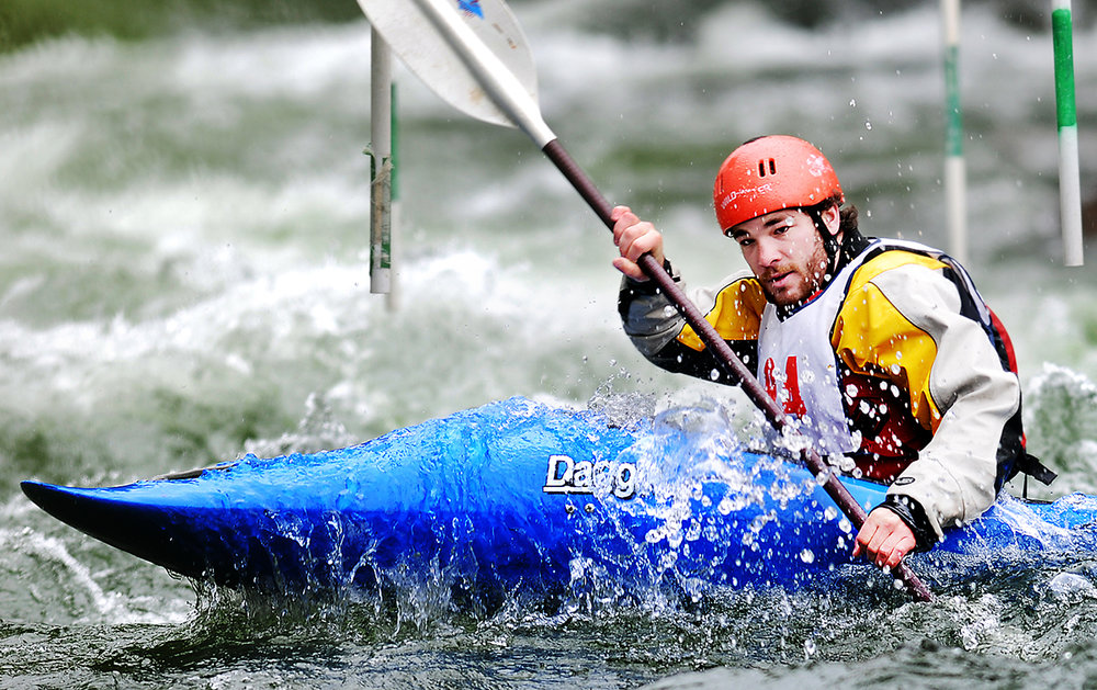 Drew Hollinger of Bigfork comes through two gates on his first run through the beginner slalom on Saturday, May 29, at the Bigfork annual Whitewater Festival. (5/29/10)