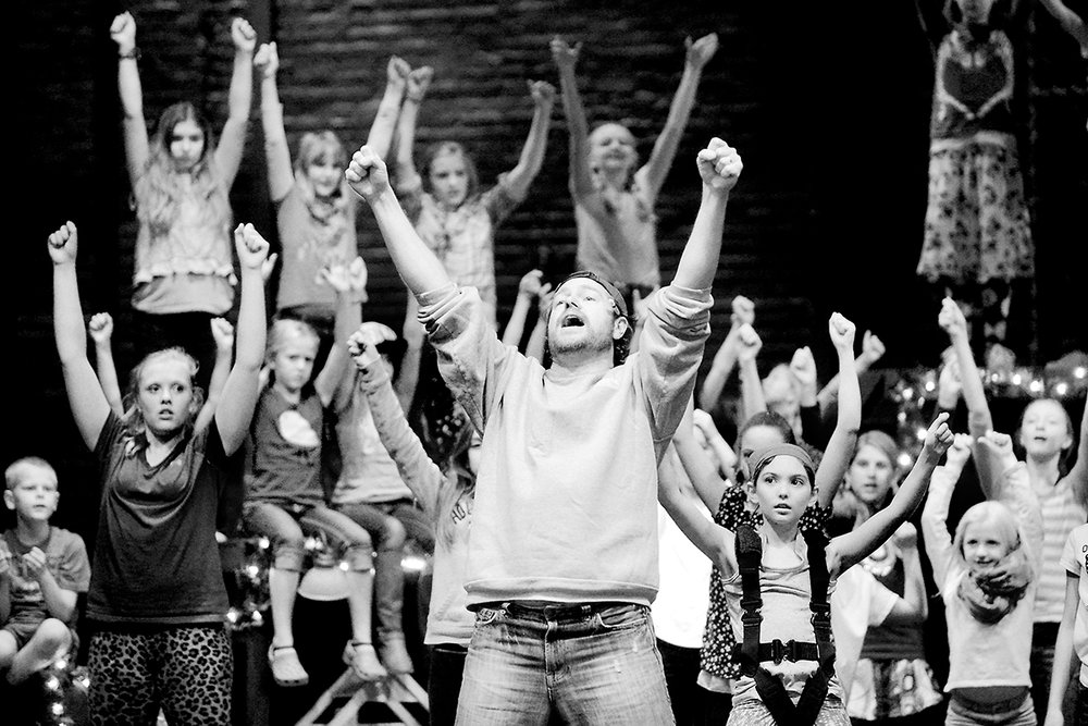 Luke Walrath (Broadway's 42nd Street) leads dozens of young actors in rehearsal for ATP's  production of Peter Pan. .