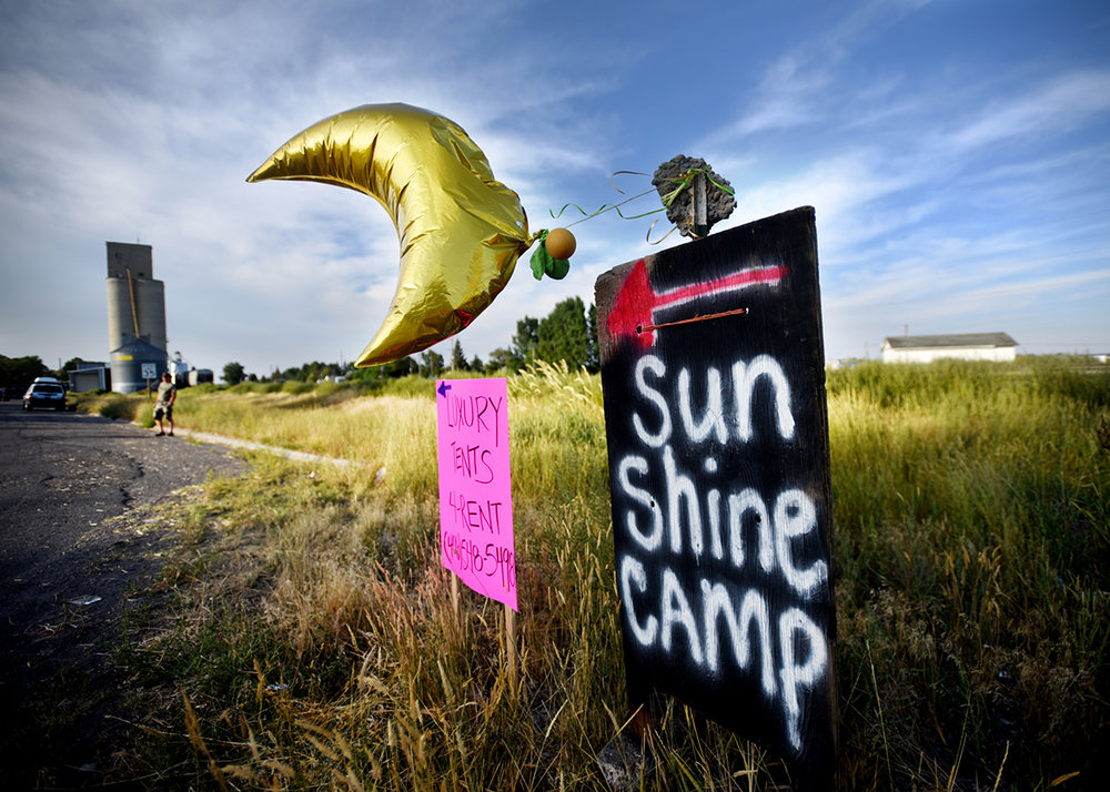On Sunday evening, the night before the Great American Eclipse, signs for places to park and camp were still up waiting for more visitors to arrive in Roberts, Idaho.