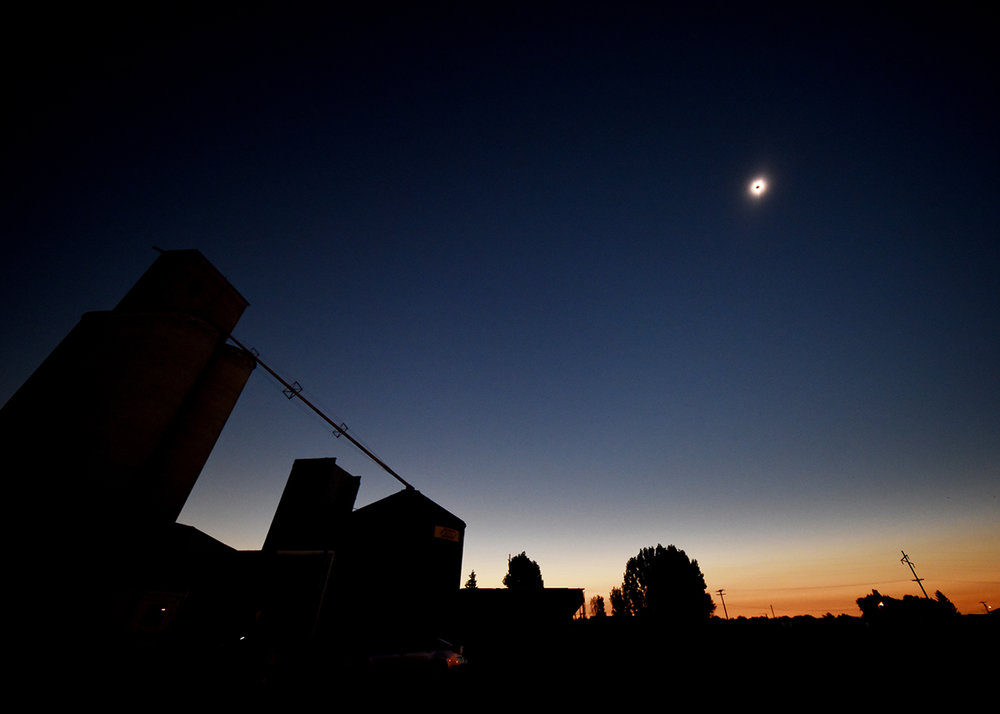 A wide view of the solar eclipse over Roberts, Idaho, on Monday, August 21. The sky above the town went completely dark, while the horizon appeared as a 360-degree sunset.