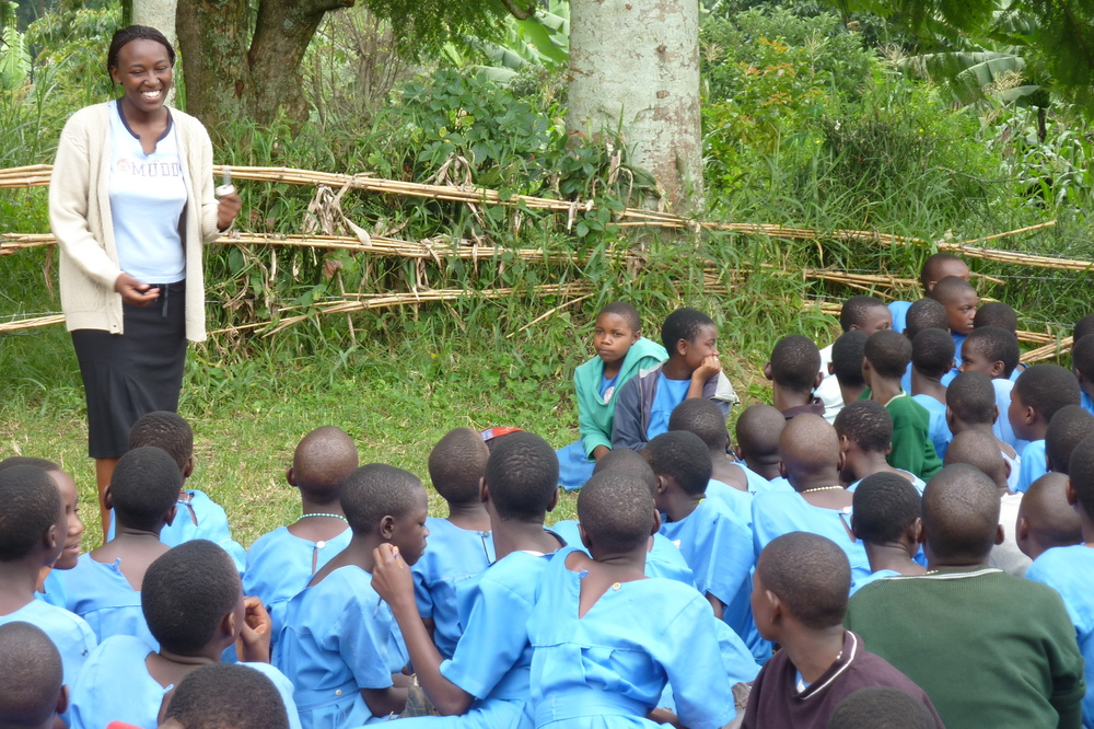 Colin Chapman believes that the upcoming generation about the value and wonders of natural systems and animals is a very effective conservation strategy.  Here Nurse Lucy from the Kibale Health and Conservation Project is talking to school children about health issues and conservation.