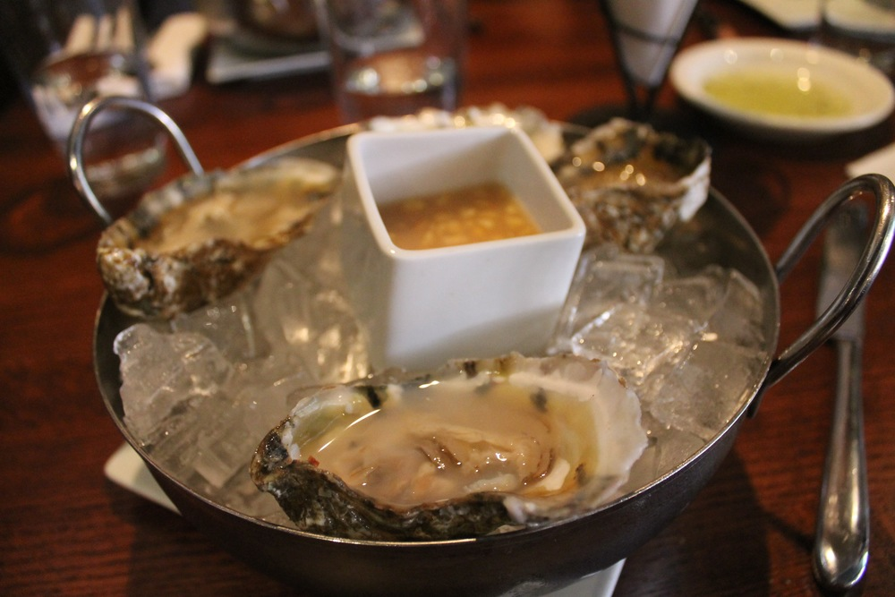 Four oysters and dipping sauce