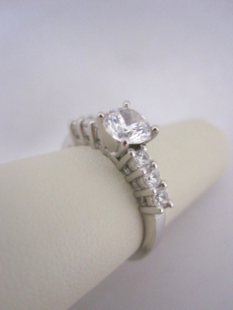Straight Row Diamond Engagement Ring with Airline in Sides