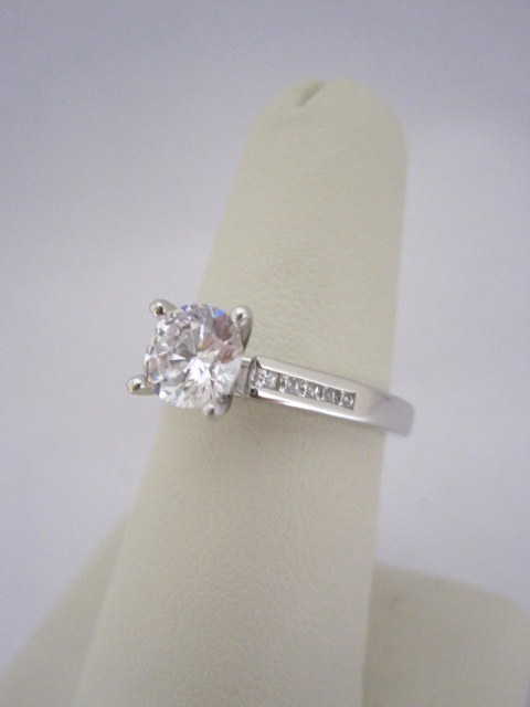 Diamond Engagement Ring with Channel Set Princess Cut Diamonds