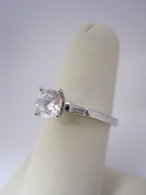Diamond Three Stone Engagement Ring with Side Baguettes