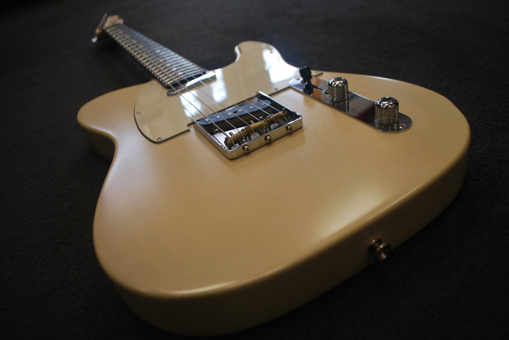 Its unique matte cream finish gives way to a beautiful relic'd look on the back and sides.