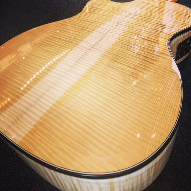 """This is the last Merida we have in stock and it's a pretty one! Closeout special price on this beautiful grand auditorium acoustic/electric with gorgeous sap-striped flamed maple back and sides with a """"bear claw"""" spruce top! This one is unique because it also features a bone nut and saddle instead of Tusq. Plays and sounds as great as it looks! Stop in and check it out before it's gone! . . . . . #guitar #music #acousticguitar #acoustic #flamedmaple #musician #guitarist #merida #beautiful #fishman @fishmanmusic"""