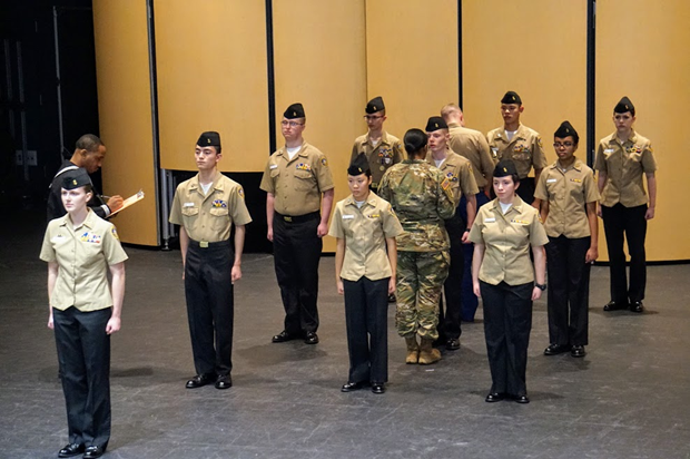 Patriot Company's Unarmed Drill Team, led by Cadet petty Officer First Class Ovsak (10) is inspected by active duty Army, Navy, and Air Force personnel prior to conducting their regulation drill routine.