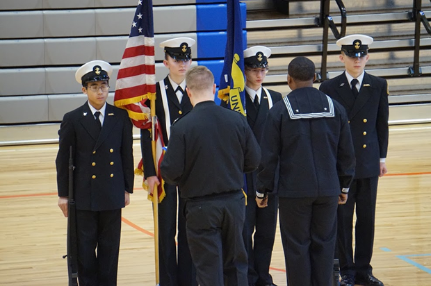 ColorGuard Team 1 , consisting of Cadets Daniel Tsang (10), Olivia Van Ry (11), Kerrek Matson (12) and Colby Van Ry (9), is inspected by active duty Navy personnel prior to their competition at Federal Way High School.