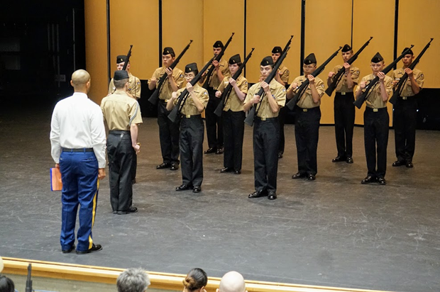 Patriot Company's Armed Drill Team, led by Cadet Lieutenant Commander Chandler Alexander (12), go to Inspection Arms in preparation for being inspected prior to conducting their regulation and exhibition armed drill routine.