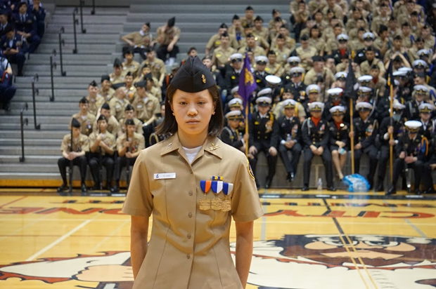 Cadet Kaitlin Lew (9) stands by to receive the Conference Iron Woman Award which is given to the female Cadet who scores the most points on the physical fitness test!