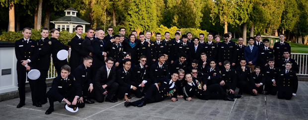 Male cadets and guests gather for a group photo.
