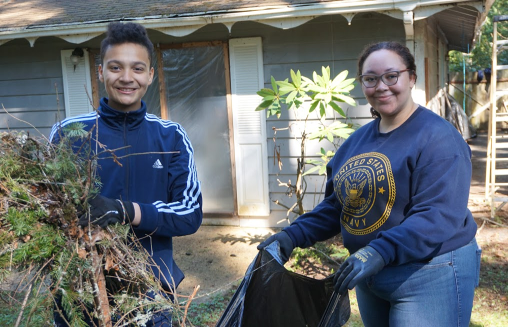 Cadets Fox Mercury and Aurora Baldwin bag branches, leaves, and pine cones that came down in the yard of Mr. Dale Brown. Over 35 extra largebags of debris were collected and disposed of.